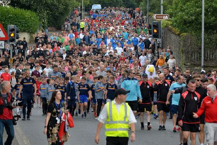 The Foyle Cup city centre parade makes its way along Northland Road towards Guildhall Square this morning. DER3019GS-