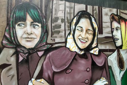 A work in progress... Inner City Trust commission UV Arts - who created the Derry Girls mural - to create new works in the Craft Village celebrating the thousands of local women who worked in the city's shirt factories.
