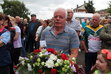 Eugene Lafferty, with a wreath that was laid in memory of his brother Eamonn on Sunday.