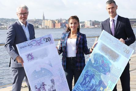 Ulster Bank launched the designs for its new ?20 notes today which are due to come into circulation in early 2020. Actress Jamie Lee O'Donnell, from Derry, attended the historical launch of the designs at the bank's Culmore Road branch. She is pictured with Terry Robb, left, Ulster Bank's Head of Personal Banking and Chris McGuinness, Local Director. ''Building on the design theme of 'Living in Nature', which was developed by a panel of experts and people from across Northern Ireland, the ?20 vertical note focuses on NI as a 'dwelling place'.''The notes will feature street entertainers and their appreciative audience, reflecting local music and culture, as well as tiles, brickwork and patterns inspired by NI's ubiquitous red-brick tenement buildings.''The note is also incorporating Derry~Londonderry's much-loved Hallowe'en celebrations into the security features of the note ' under a UV light, skeletons and Leisler's bat ' the largest type of bat in Ireland ' can be seen.''Other elements of the note are drawn