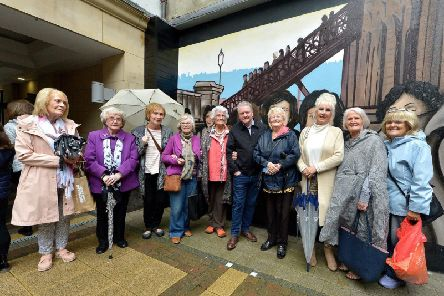 Artist Joe Campbell pictured with former factory girls at the launch of the Factory Girls mural in the Craft Village.