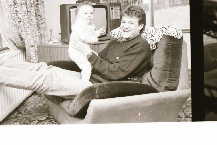 Alex Krstic relaxing with his baby son, Alexander at their home in Lisfannon in 1987.