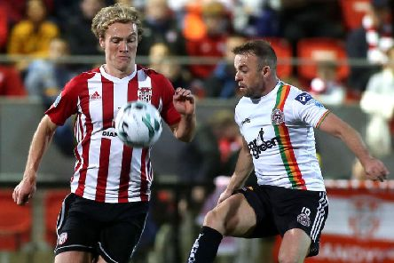 Derry City's Greg Sloggett tussles with Bohemians Keith Ward.