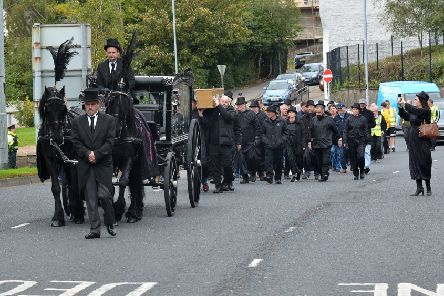 A march and rally, organised by Action Against Cuts, and led by a horse drawn hearse, makes its way along Duke Street towards Guildhall Square on Saturday afternoon last. DER4019GS ' 026