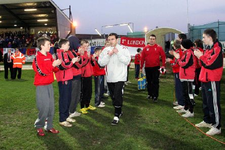 Pat Fenlon, pictured leading Derry City out onto Brandywell for the Setanta Cup clash with Linfield in March 2007, believes an All Island League could benefit both the Irish League and League of Ireland.