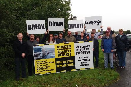 Representatives from the Border Communities Against Brexit group pictured at a previous protest on the Derry-Donegal border.