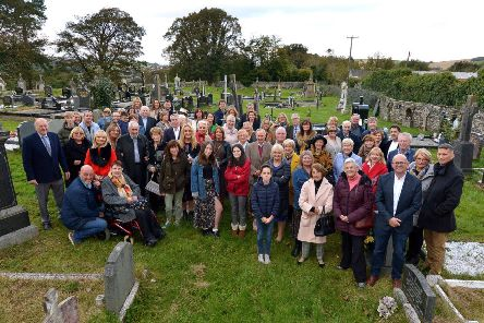Members of the O'Doherty Clan pictured in Ardmore Cemetery, during a visit to the grave of their ancestor Charles O'Doherty, who died in 1915. The visit to the cemetery was part of the O'Doherty Clan Reunion events held in the Beech Hill Hotel last weekend. DER4119GS ' 061