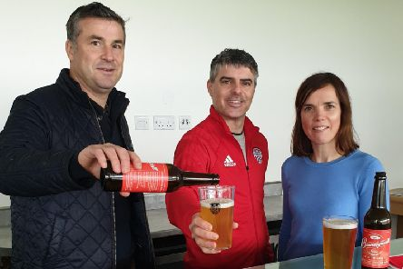 David Rogers pours a Brandywell Brew for City Director, Declan Callaghan, watched by Martina Rogers of Northbound Brewery