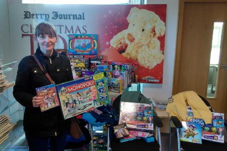 The true meaning of Christmas... Helen Mitchell with just some of her donations to the Derry Journal Toy Appeal. Helen told the Journal she and her husband purchase toys and clothing for children throughout the year as they didn't want any child to miss out on Christmas morning. Thank you to Helen, her husband and all the others who have donated to the appeal so far.