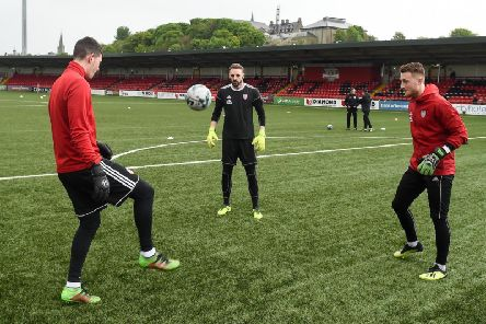Derry City goalkeepers, Nathan Gartside and Peter Cherrie warm up on matchday.