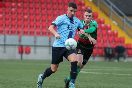 Institute's Joe McCready and Glentoran's Christopher Gallagher at Brandywell on Saturday.