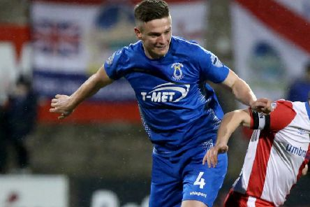 Dungannon Swifts' skipper Douglas Wilson made no mistake from the penalty spot against Institute.