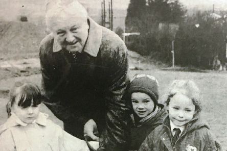 Banbridge Councillor Archie McKelvey cuts the first sod for the new school at Kinallen in 1996 with help from Melanie Barlow, Debbie Johnston and Andrew McCammon.
