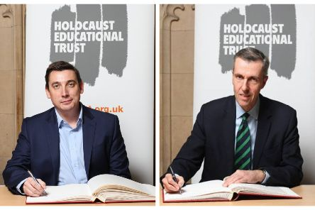 Gavin Shuker MP and Andrew Selous MP signing the Holocaust Educational Trust's Book of Commitment.