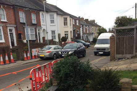 The resident's photo of  a car mounting a pavement near the crossing - 'It's not a safe place to walk'.