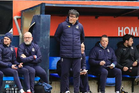 Hatters boss Mick Harford watches on against Gillingham