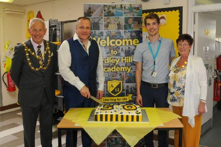 Headteacher cuts the Anniversary Cake. Photo by John Chatterley