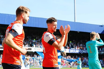 Harry Cornick applauds the Town fans on Saturday