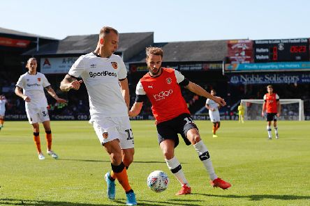 Andrew Shinnie looks to challenge Hull's Kamil Grosicki