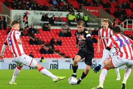 Luke Berry takes on his man at Stoke City on Tuesday night