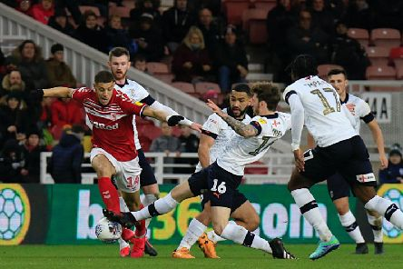 Glen Rea sides in to make a challenge during Luton's win at Middlesbrough on Saturday