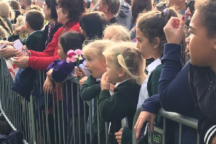 A youngster is open-mouthed with awe during the royal visit