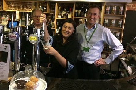 Wealden MP Nus Ghani pulls a pint SUS-181017-112540001