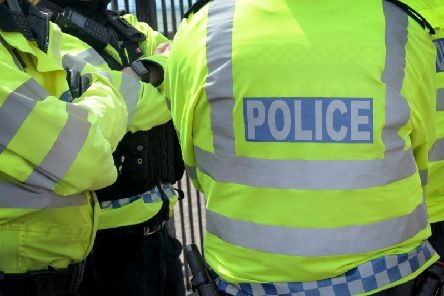 Three men have been charged by police in connection with a rape on a Sussex town's seafront