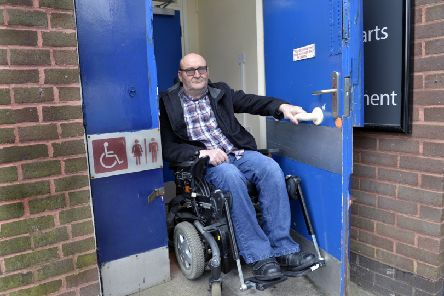 Ian Westgate who is unhappy that the refurbishment of Langney shopping centre in Eastbourne does not include a disabled toilet (Photo by Jon Rigby) SUS-190404-093715008