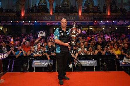 Rob Cross with the trophy. Picture by Chris Dean/PDC