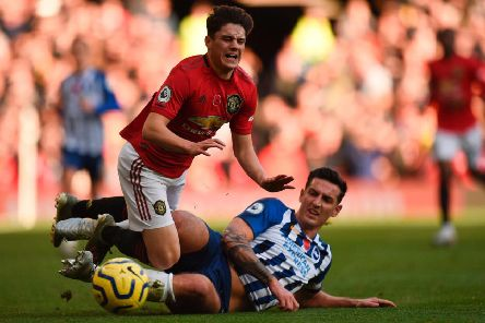Brighton and Hove Albion captain Lewis Dunk was booked for this late challenge on Manchester United's Dan James.