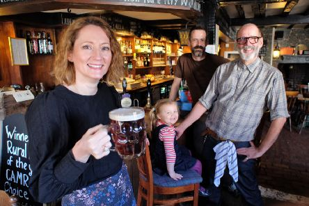 Owner of the Ye Olde Smugglers Inne, in Alfriston, Lisa Thompson with daughter Charlotte and staff members Barry Flannegan (front) and Darren Sandalls. Photograph: Peter Cripps/ SUS-190711-072614008