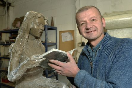 Ado with one of his sculptures at his studio in Eastbourne (Photo by Jon Rigby) SUS-191121-101219008