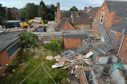 Work has started on demolishing the old Cottage Hospital on Coventry Road in Market Harborough. PICTURE: ANDREW CARPENTER