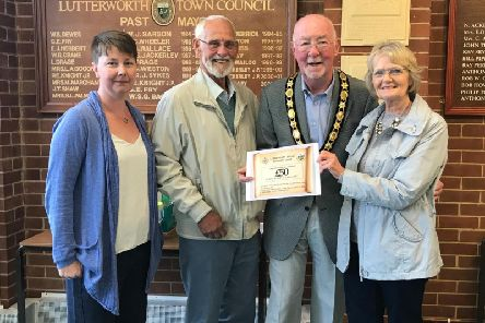 Mr and Mrs Wasik receiving their voucher from Cllr Tony Hirons, accompanied by Clare Morris a member of the Lutterworth Retail Forum.