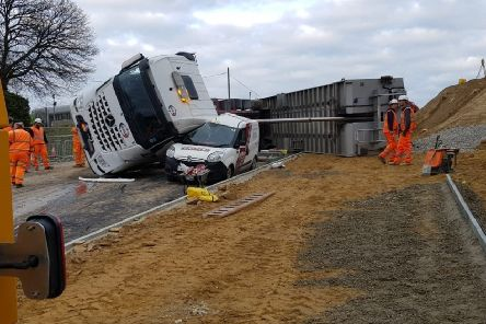 A lorry has toppled over on the Queensway Gateway road