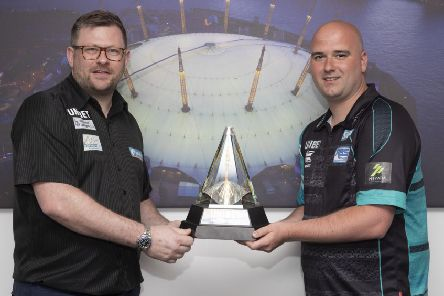 Rob Cross (right) and semi-final opponent James Wade with the Unibet Premier League trophy. Picture courtesy Lawrence Lustig/PDC