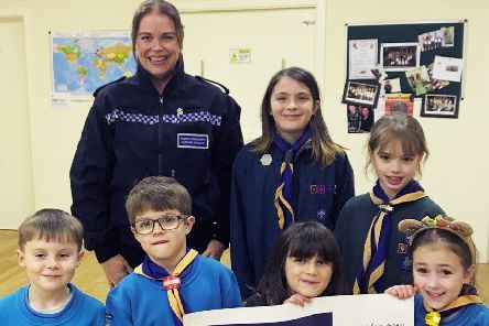 Bexhill Scout Group receives the donation from police in Rother