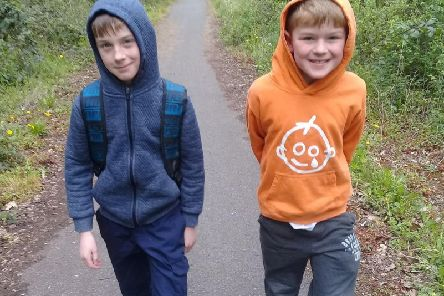 Liam, right, alongside his supportive older brother Thomas