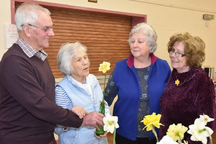 Daffodil judge Bill Parrott pointing out the finer points of a prize winning bloom to members Jean Thompson, Chairlady Chris Raynor and Sheila Minns. EMN-190404-163730001