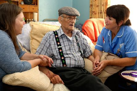 Marie Wootton (right) with a hospice resident and visitor.