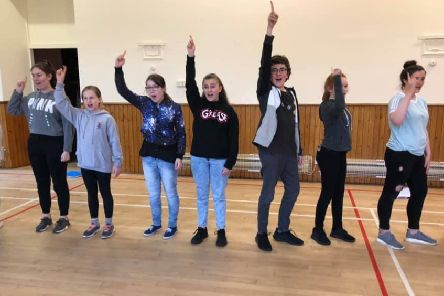 Cast members rehearsing for the upcoming show