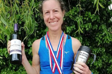 Leamington C&AC's Sue Harrison celebrates after a winning run at the Burton 10. Pictures submitted