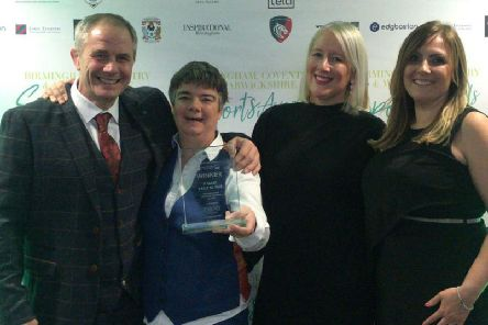Officials from the It Takes Balls to Talk campaign accept their award