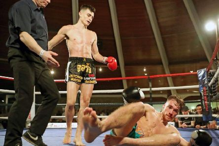 George Mouzakitis towers over Luke Hill after his fourth-round knockout.