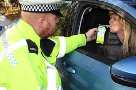 Warwickshire Police officer conducting a breath test