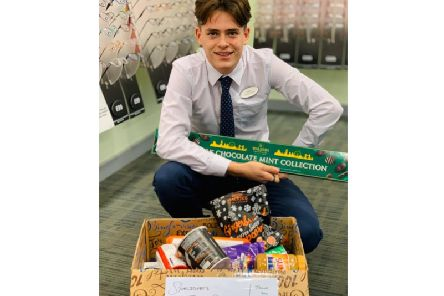 Aidan Pearce, clinical assistant at Specsavers Kenilworth with some of the items that have already been collected.