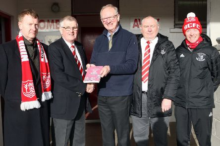 Robson Davison (centre), author of 'The Comrades, presents Trevor McCann, chairman, with the first copy of the special centenary book. Looking on, from left to right, are Seamus Reid, Reid Black Solicitors; Robert Fleck, treasurer and Justyn Wallace, committee member. 'Picture by Freddie Parkinson.