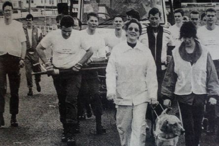 Members of the Brae Club pulling the four tonne coal truck out of Ballygally. 1989.