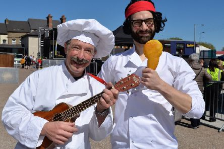 The Singing Chefs entertaining in the market yard. INLT 18-007-PSB